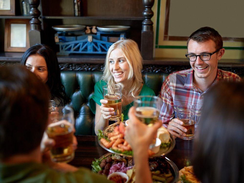 Group of friends enjoying drinks at restaurant