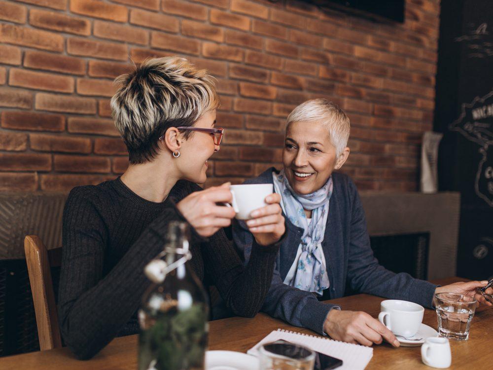 Two elderly women having a conversation