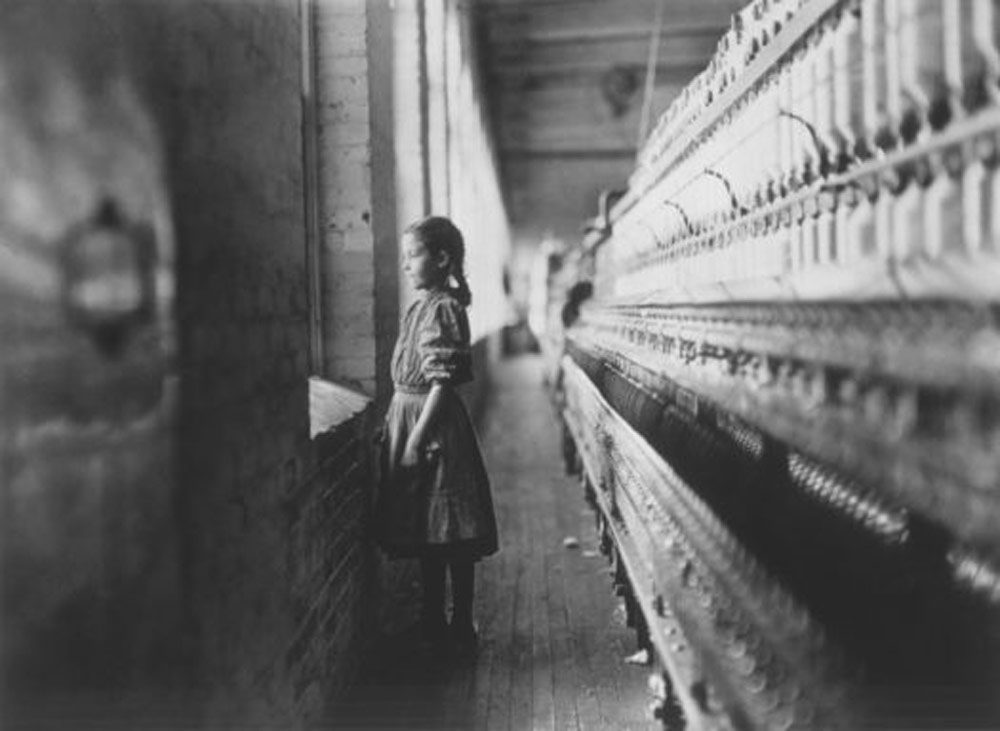 Young girl working at a cotton mill