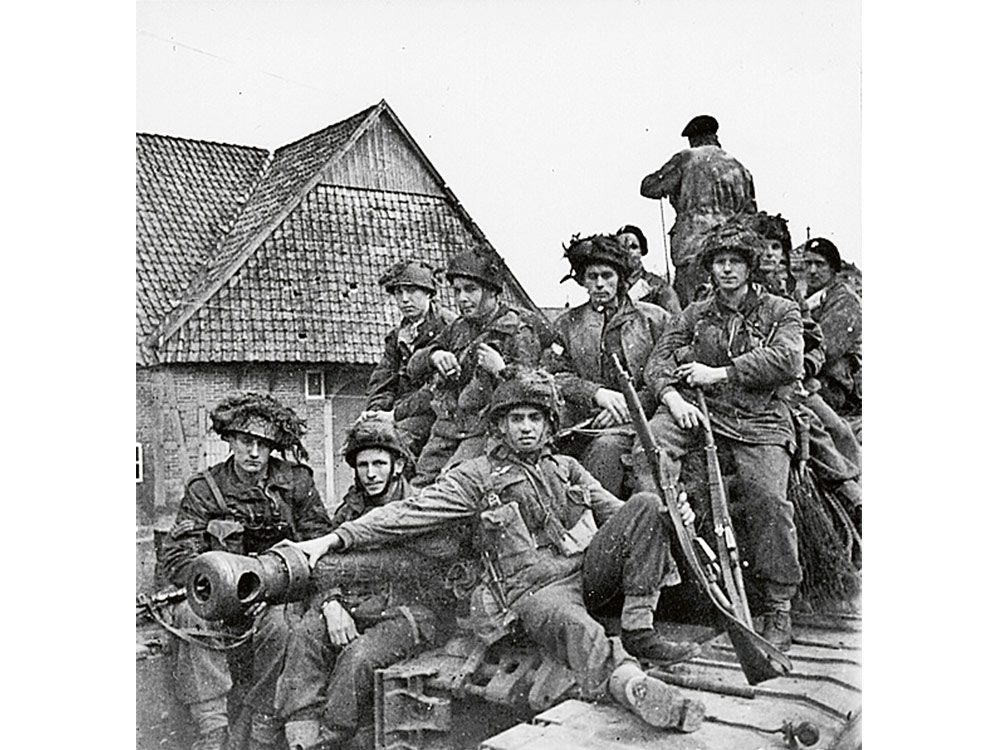 The First Canadian Parachute Battalion hitching a ride on a Churchill tank