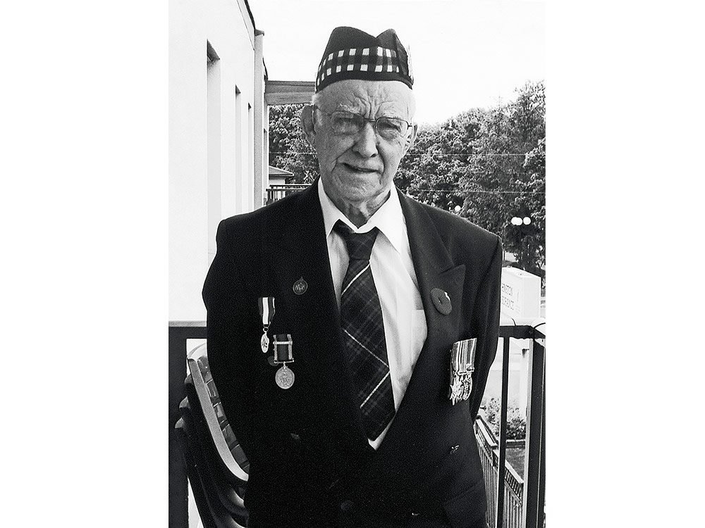 Orval Gibbons standing outside The Royal Canadian Legion Branch, in Orillia, Ont. 2009