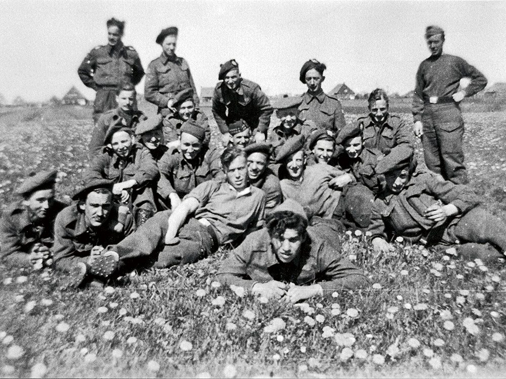 Gibbons—second from left, with moustache—lying with his regiment. 1944