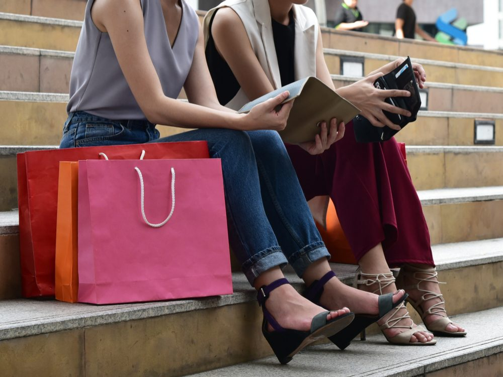 Two women resting after a shopping spree