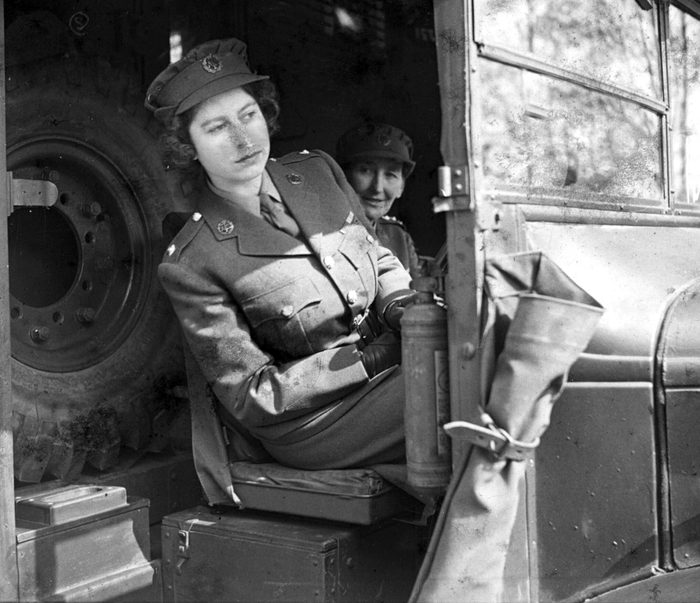 PRINCESS ELIZABETH AT THE WHEEL OF AN AMBULANCE WHILE A SECOND SUBALTERN IN THE A.T.S. - APRIL, 1945