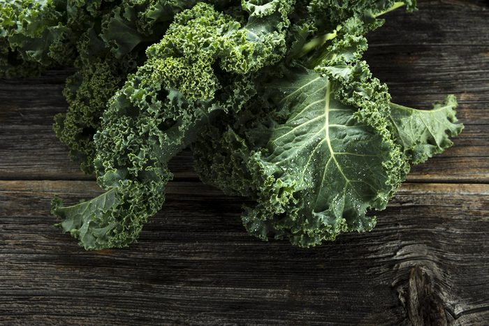 Foods everyone over 50 should be eating - Organic kale with water droplets in closeup