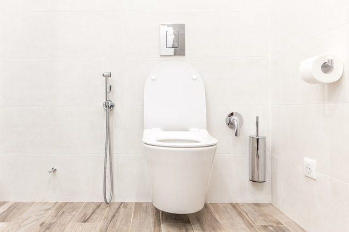 Toilet bowl in modern bathroom