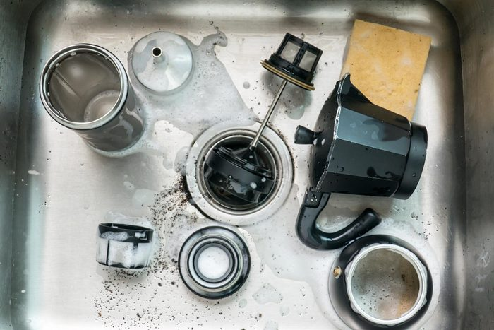 sink dirty dishes coffee maker