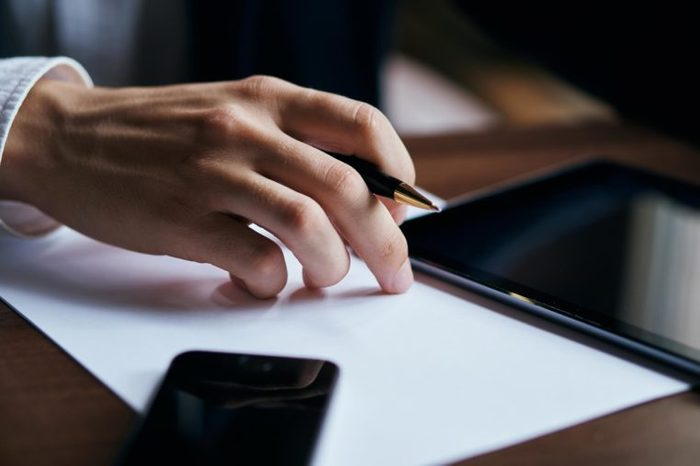 tablet, pen in businessman's hand, phone