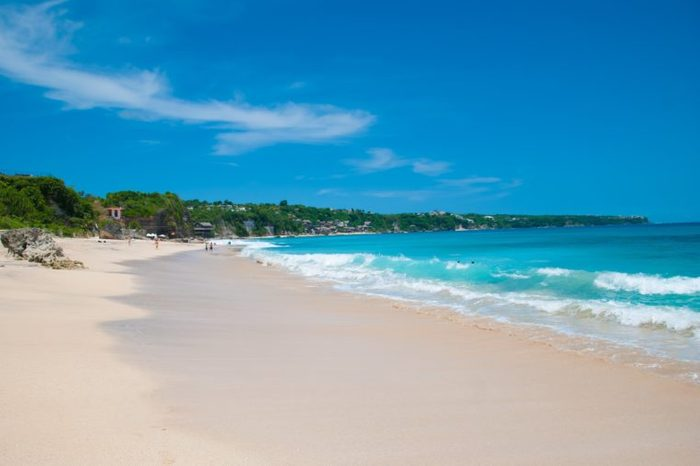 Sunny beach called Dreamland in Bali, Indonesia.