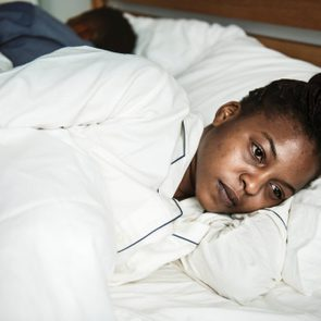 A woman wide awake in bed