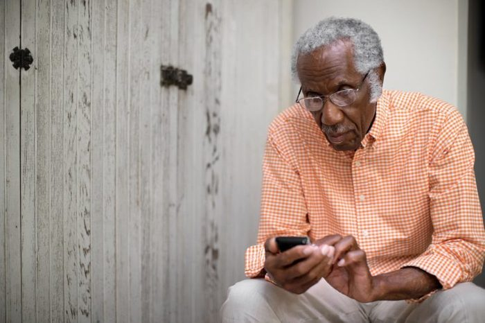 Old man using cell phone
