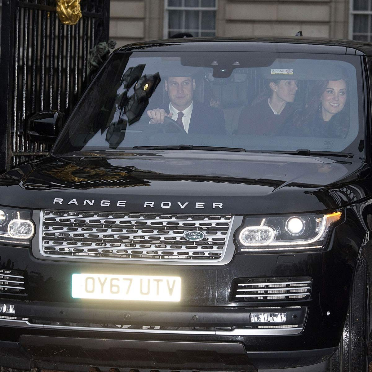 Prince William and Catherine Duchess of Cambridge drive in a black Range Rover