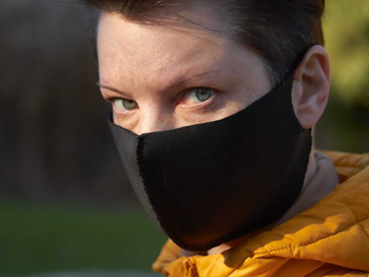 Woman wearing black face mask