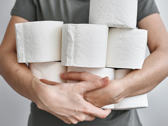 what your poop says about your health - arms full of toilet paper