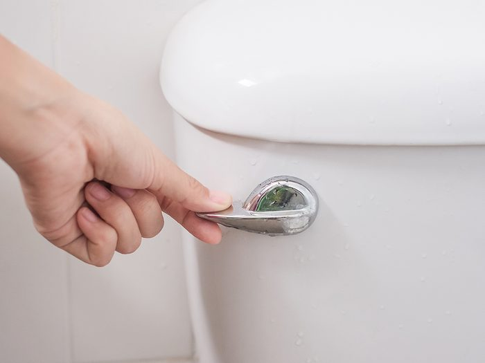 What your poop says about your health - hand flushing toilet