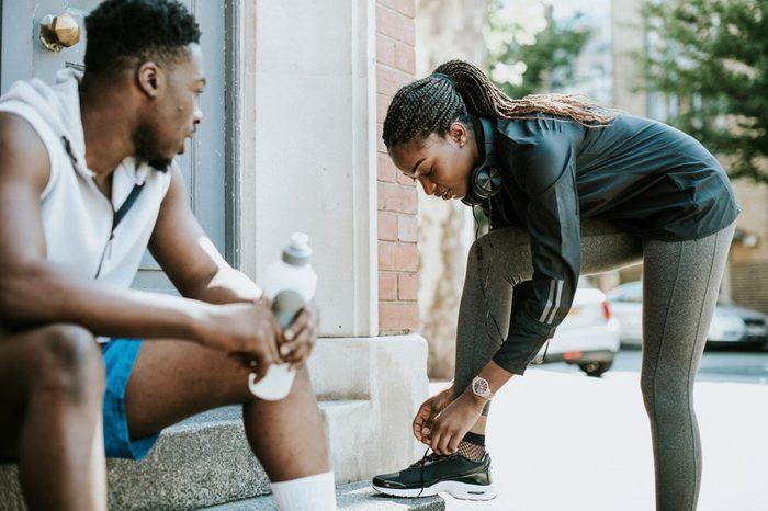Athletic girl tying her shoelaces