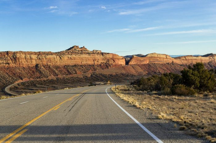 Scenic Highway 95 in Southeastern Utah with a beautiful sandstone wall intersected by the road