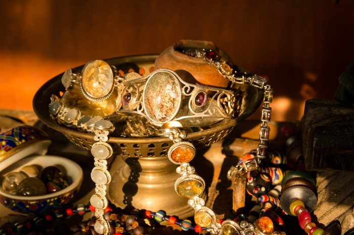 Still life with Jewelry old silvers in old brass tray,Concept of old treasures