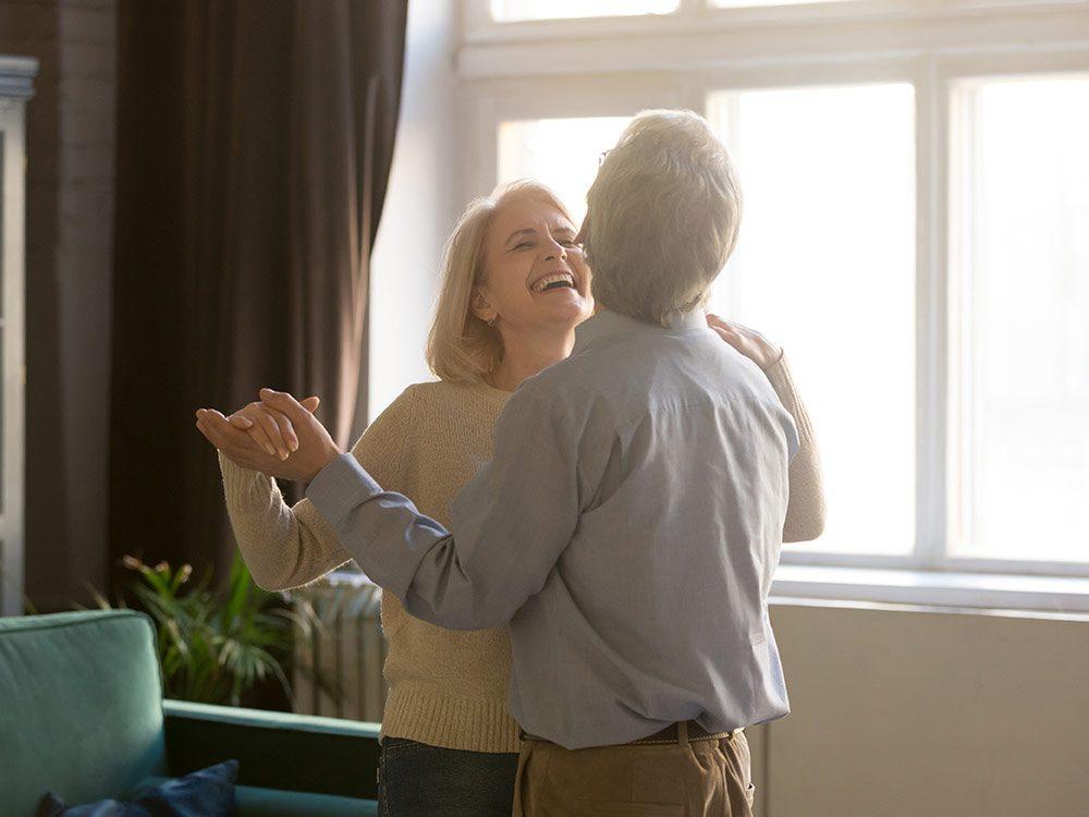 Elderly Caucasian couple dancing