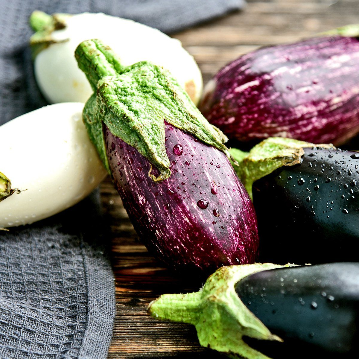 3 colorful mixed of Eggplant (Solanum melongena) or aubergine with water drop.