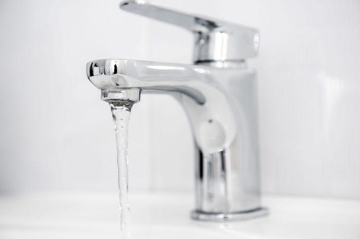 Water tap flowing in The bathroom