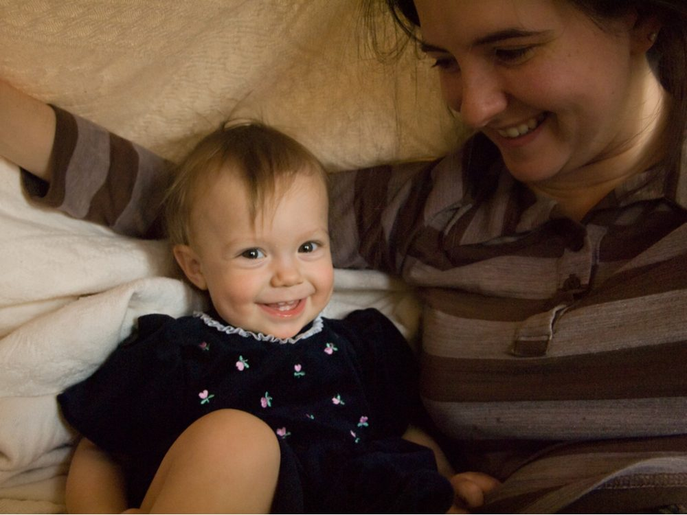 Mother and daughter in blanket fort