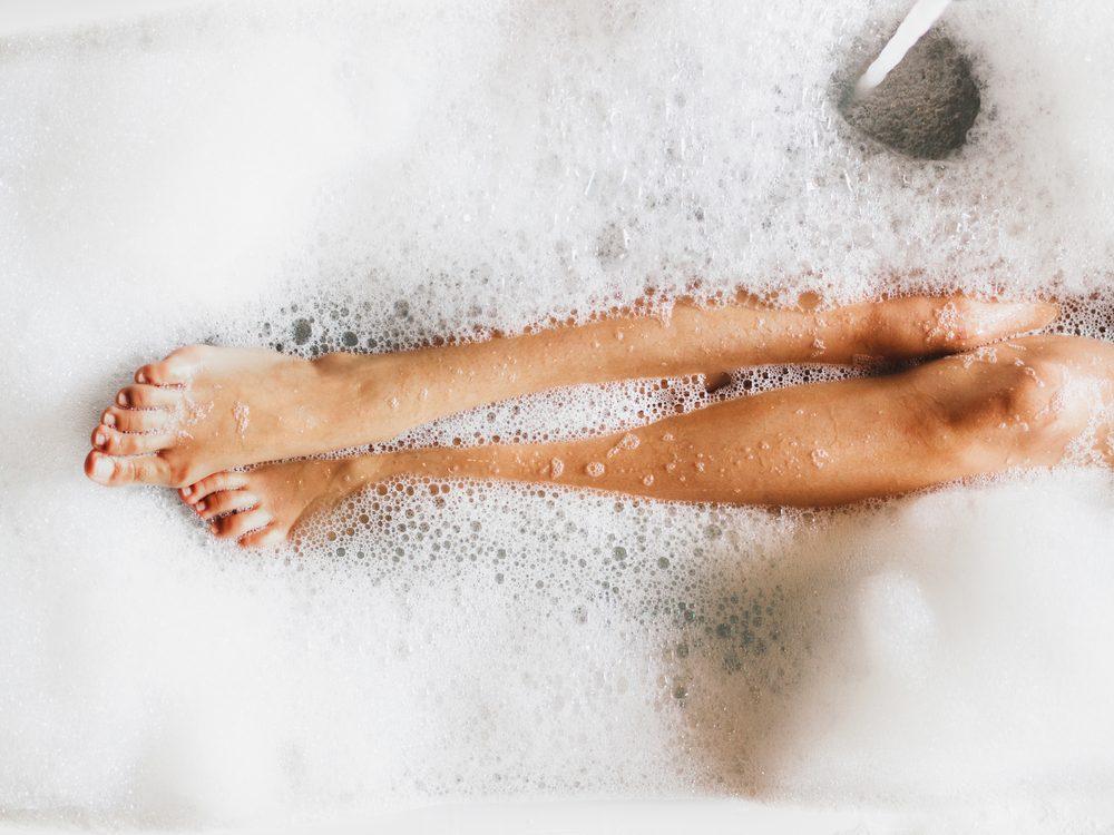 Woman's legs in bubble bath