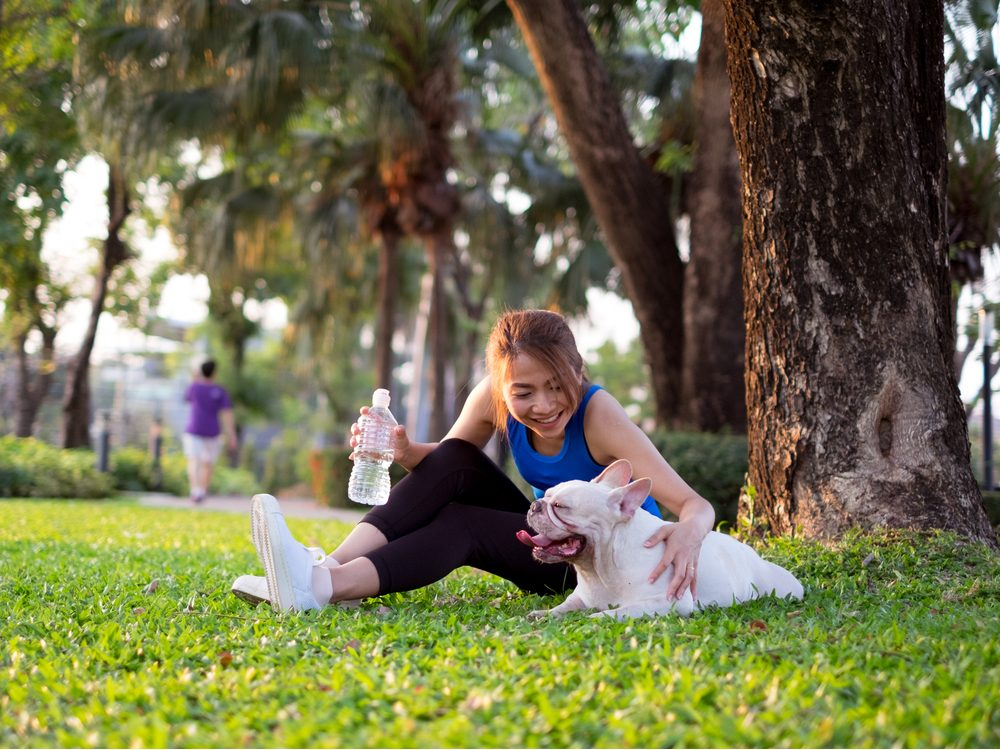 Asian woman with her dog at the park