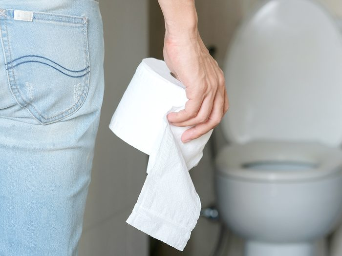 What your poop reveals about your health - toilet paper in hand