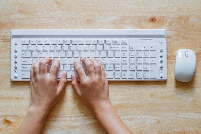 hand working keyboard computer