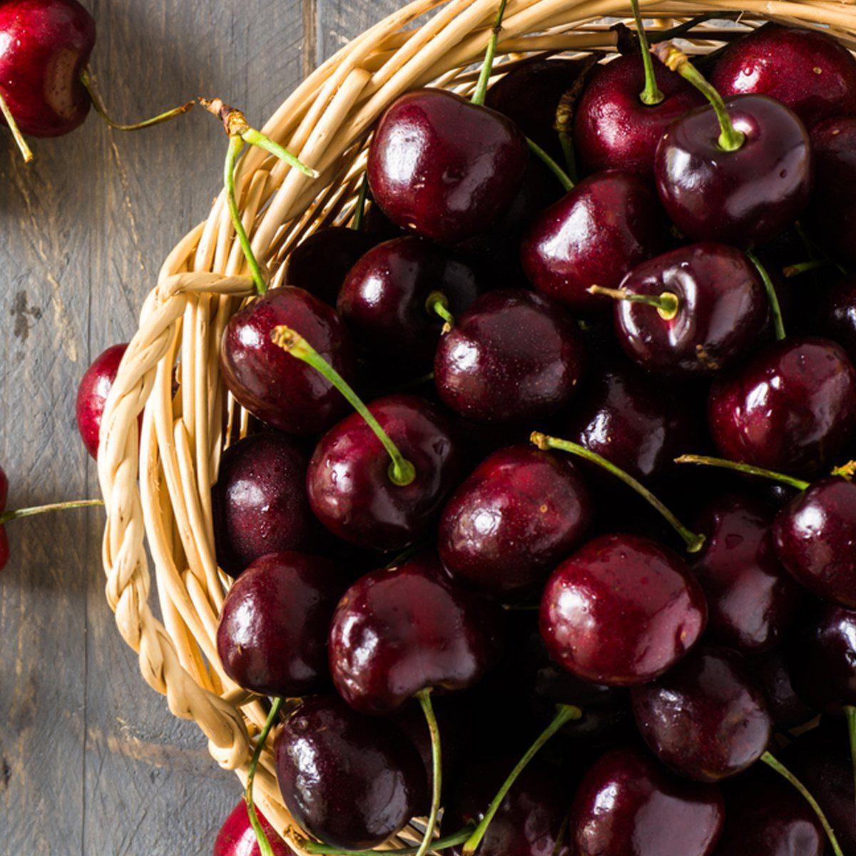 bunch of cherries in a wicker basket
