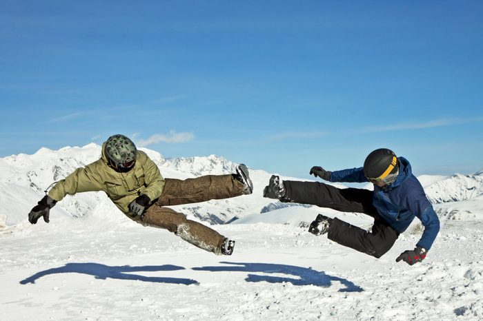 Funny jumping guys in winter mountains
