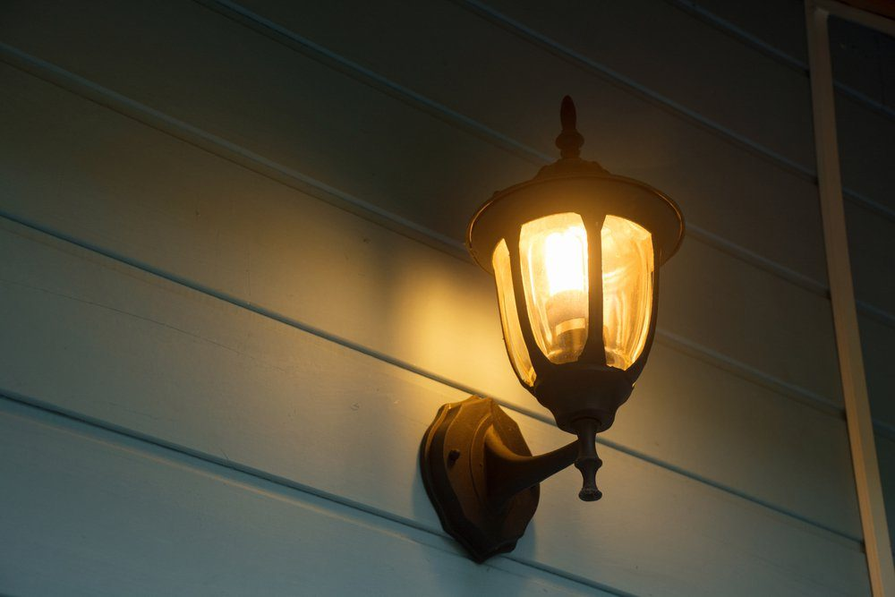 Warm light of external lamps on the house wall