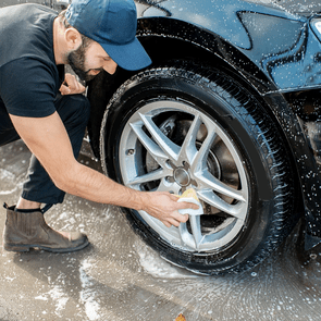 Cleaning tricks from car washers - Man washing car