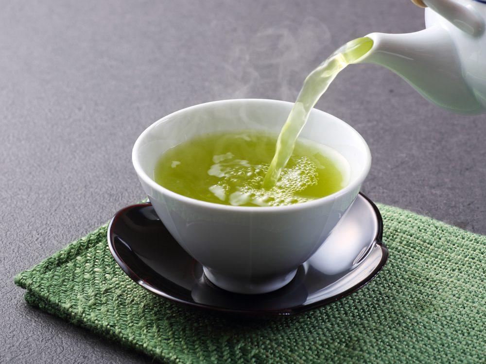 Pouring matcha green tea