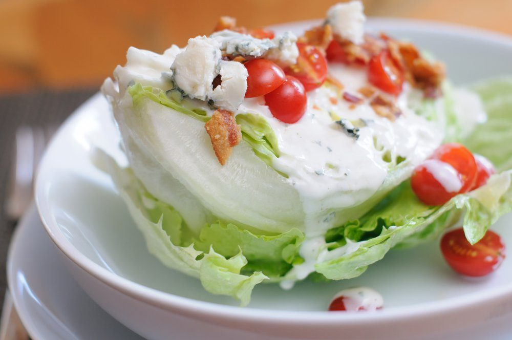 Tasty Iceberg Lettuce Wedge, Topped with Tomatoes, Blue Cheese and Bacon