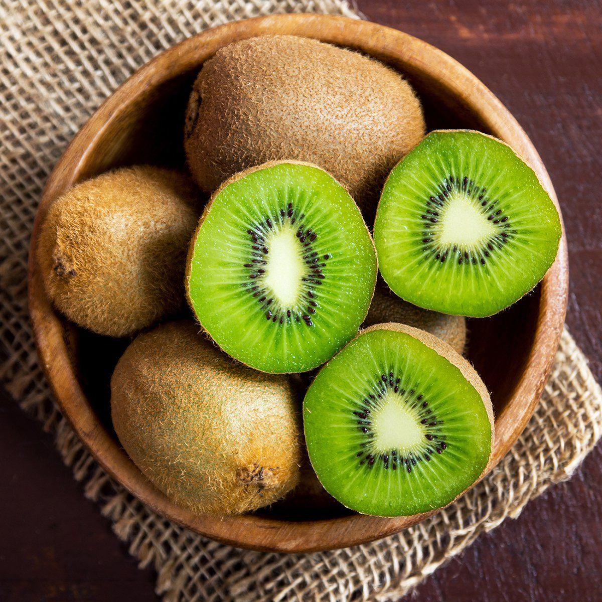 Kiwi fruit on wooden background