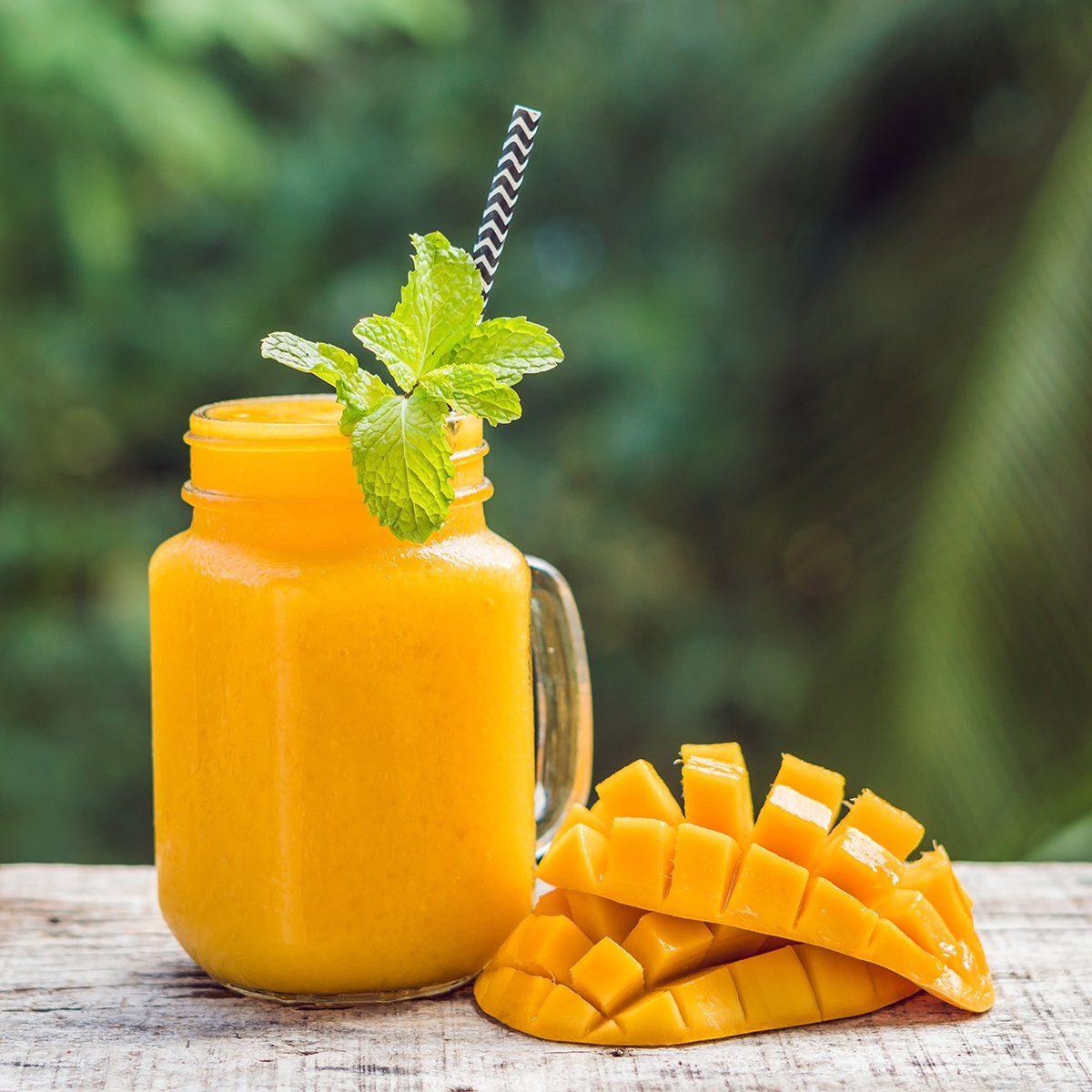 Mango smoothie in a glass Mason jar