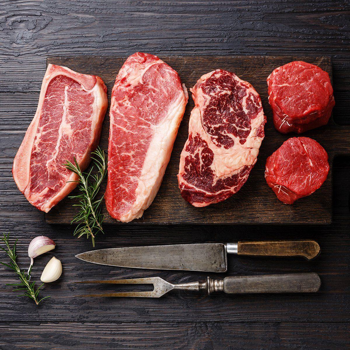 Variety of Raw Black Angus Prime meat steaks Blade on bone