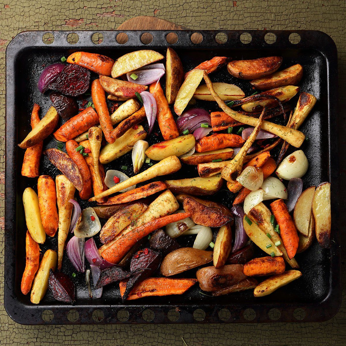 Roasted vegetables mix on baking tray, food above