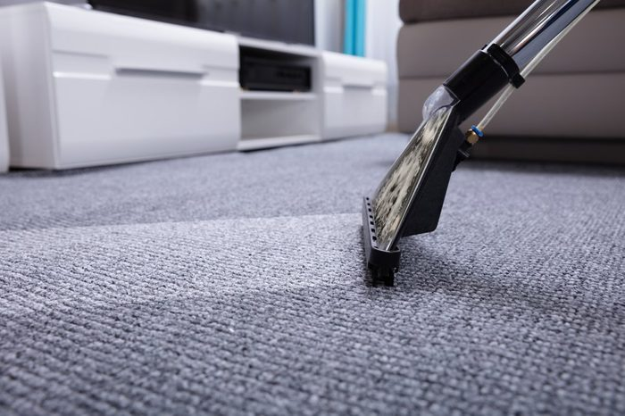 Close-up Of A Vacuum Cleaner Over Grey Carpet
