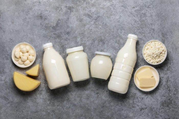 Dairy products such as milk, yogurt, butter, cheese, cream and kefir, view from above, space for a text