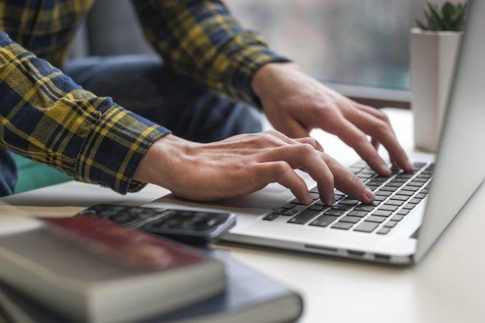 Man hands working on laptop