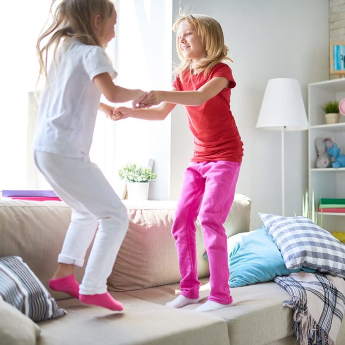 shutterstock_695124241-1200x1200 little girls jumping on couch furniture