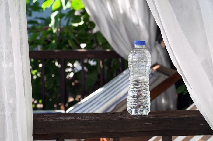 Clear Plastic bottle with water standing on a terrace