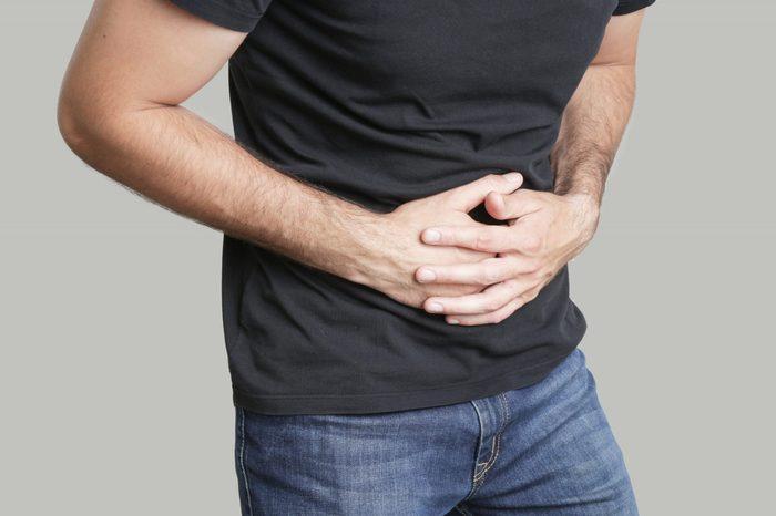 Man having painful stomach ache, chronic gastritis or abdomen bloating