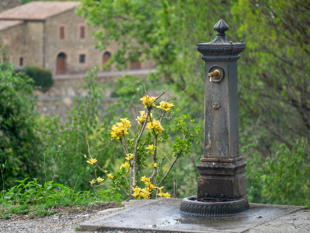 Old public water fountain in Italy