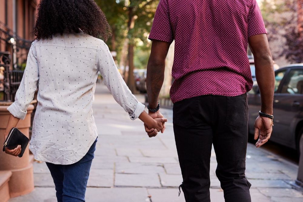 natural remedies for high blood pressure - Rear View Of Couple Walking Along Urban Street In New York City