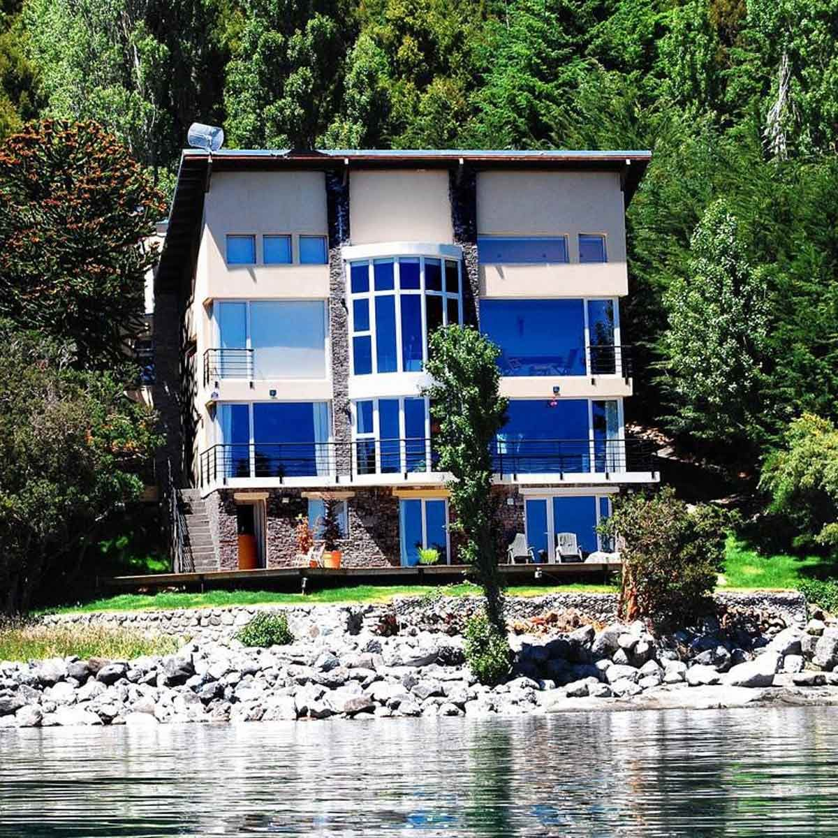 three-story mansion on the water in Argentina