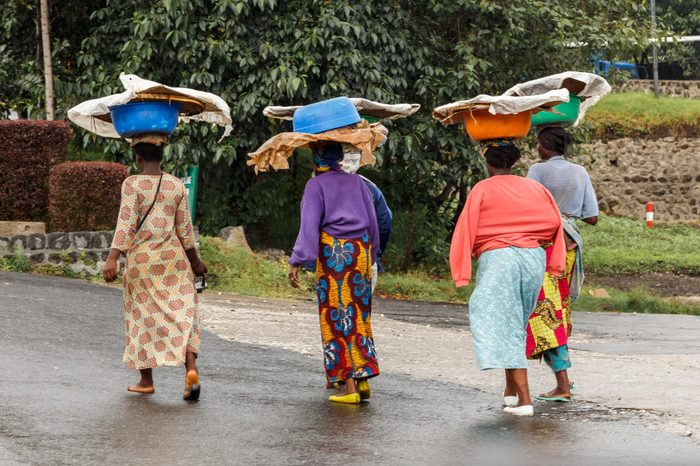 Group of Rwandan women in colorful traditionals clothes wearing washbowls on their heads, Kigali, Rwanda